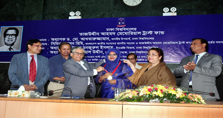 Dhaka University Vice-Chancellor Prof. Dr. Md. Akhtaruzzaman distributed Tajuddin Ahmad gold medal, scholarship and prizes among the students as chief guest at a function held today October 08, 2017 at Nabab Nawab Ali Chowdhury Senate Bhaban of the university. Tajuddin Ahmad Memorial Trust Fund of DU organized the program. Awardees are seen with the guests. (Picture- DU PR Office)