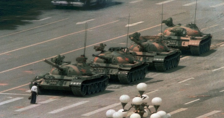 A Chinese man stands alone to block a line of tanks heading east on Beijing's Cangan Boulevard in Tiananmen Square on June 5, 1989. China faced unprecedented criticism of its brutal repression of unarmed citizens demanding more freedoms. More recently, China has begun promoting its model of