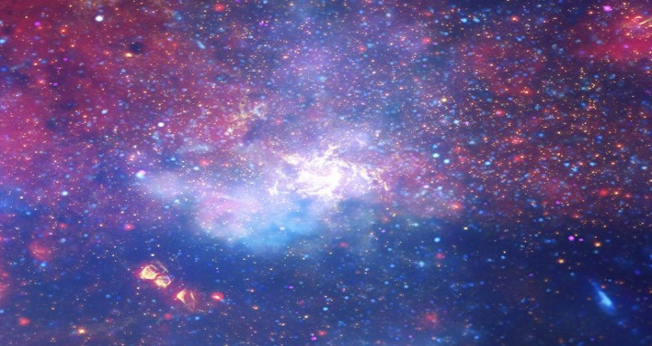 A multiwavelength view of the field around the Milky Way's galactic center seen from the X-ray (blue) through the infrared (red). Astronomers have measured flaring events at multiple wavelengths coming from the supermassive black hole at the very center. X-ray: NASA/CXC/UMass/D. Wang et al.; Optical: NASA/ESA/STScI/D.Wang et al.; IR: NASA/JPL-Caltech/SSC/S.Stolovy